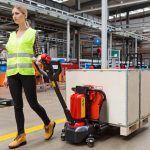 woman doing material handling at warehouse