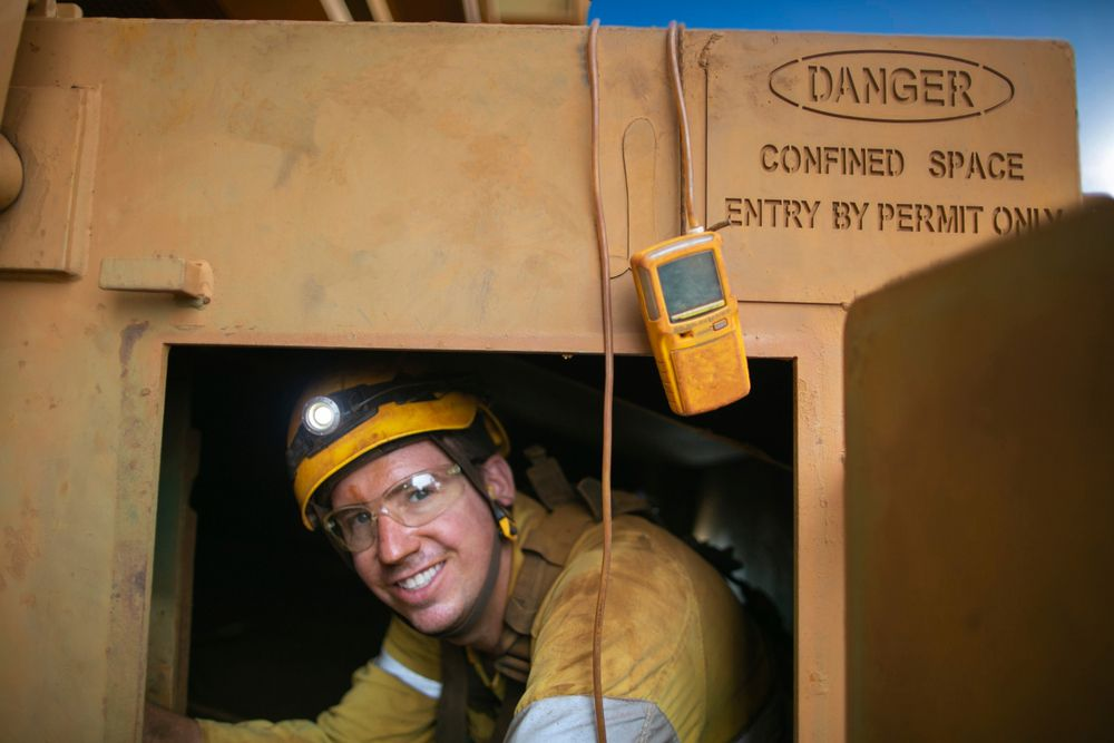 worker tests gas in confined space