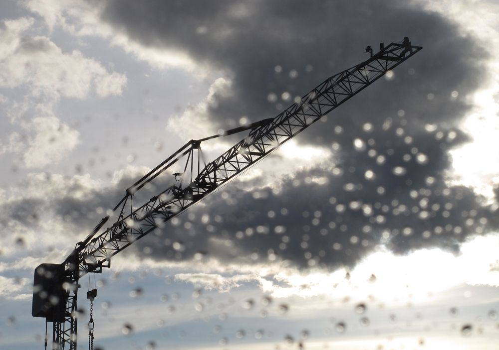 crane in the rain at an empty construction site