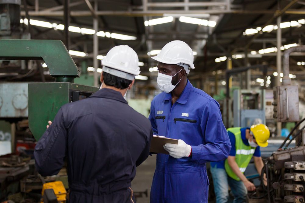 supervisor and safety auditor assessing workplace gap analysis