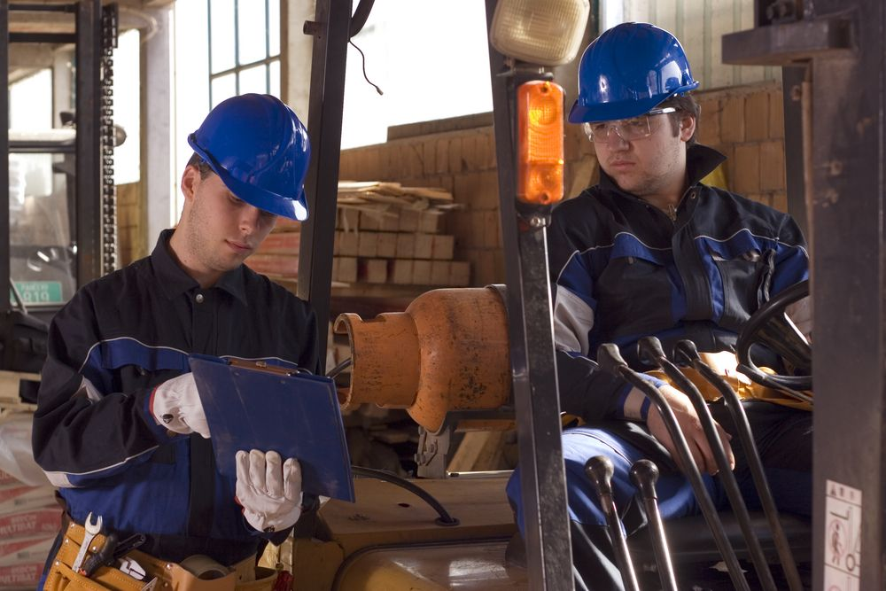 safety consultant talking to a forklift operator about safety and hazards