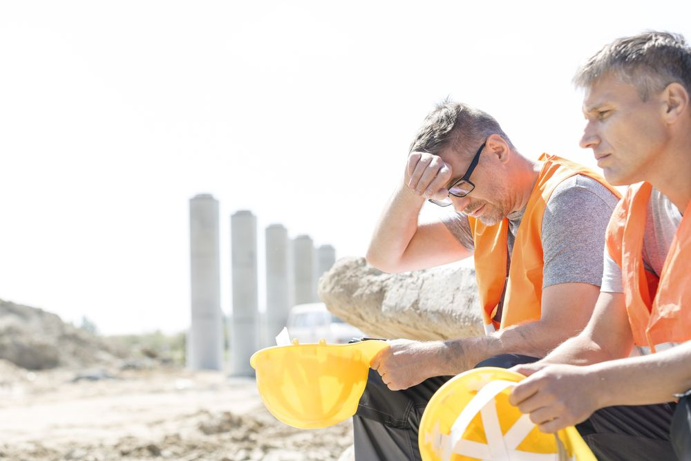 tired construction workers
