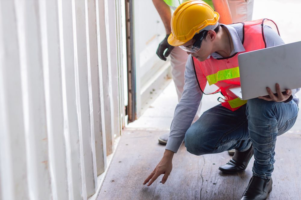a safety inspector reviewing the workplace to spot any gaps in their program