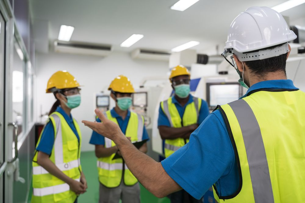 safety professional conducting training for current employees in at a workplace